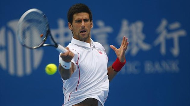 Serbia's Novak Djokovic returns a shot during his match against Lukas Rosol of the Czech Republic at the China Open tennis tournament in Beijing October 1, 2013 (Reutersre)