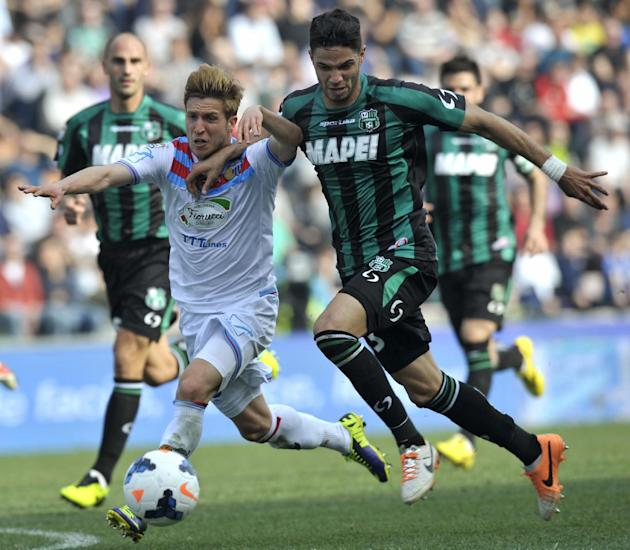 Sassuolo's Pedro Mendez of Portugal, right, competes for the ball with Catania's Sergio Gontan Keko of Spain, during their Serie A soccer match at Reggio Emilia's Mapei stadium, Italy, Sun