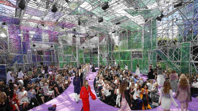 Models present creations by Belgian designer Simons as part of his Haute Couture Fall Winter 2015/2016 fashion show for French fashion house Christian Dior in Paris