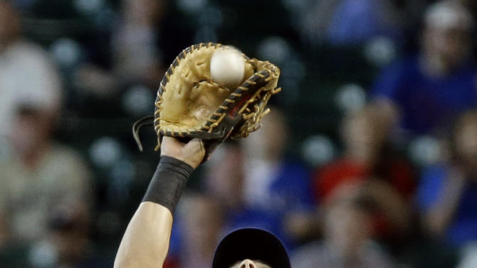 Texas Rangers' Ian Kinsler makes the catch and the out on Houston Astros' Matt Dominguez in the third inning of a baseball game Wednesday, April 3, 2013, in Houston. (AP Photo/Pat Sullivan)