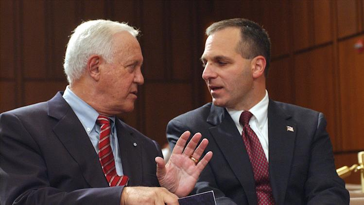 FILE - This Oct. 8, 2002 file photo shows former New Hampshire Sen. Warren Rudman, left, talking with former FBI Director Louis Freeh on Capitol Hill in Washington. Rudman, who co-authored a ground-breaking budget balancing law, championed ethics and led a commission that predicted the danger of homeland terrorist attacks before 9/11, has died. He was 82.  (AP Photo/Dennis Cook, File)