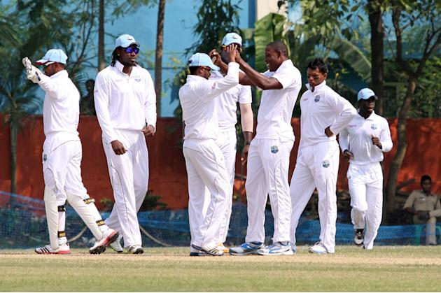 West Indies players celebrate fall of wicket during day three of practice match between West Indies and Uttar Pradesh Cricket Association XI at the Jadavpur University Ground in Kolkata on 2 Nov 2013.