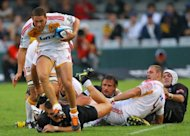 New Zealand Waikato Chiefs&#39; Tawea Kerr- Barlow (L) runs to score a try during their Super 15 rugby union match against Sharks of Durban at the Mr Price Kings Park Rugby Stadium, in April. The Chiefs will be looking to consolidate top spot on the table when the series resumes this weekend after the international season break