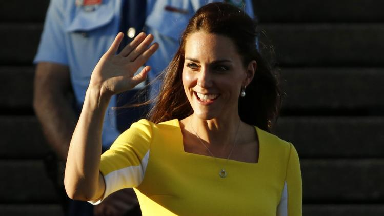 Britain's Catherine, Duchess of Cambridge, waves from the top of the steps in Sydney