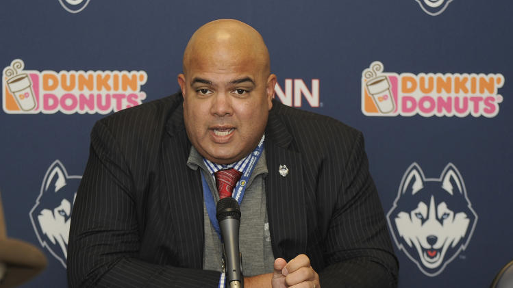 Connecticut athletic director Warde Manuel speaks to members of the press before an NCAA college football game between Memphis and Connecticut, in East Hartford, Conn., on Saturday, Dec. 7, 2013. (AP Photo/Fred Beckham)
