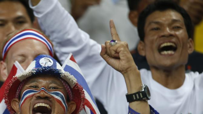 A Thai supporter cheers at the end their Suzuki Cup Group B match against Singapore at National Stadium in Singapore