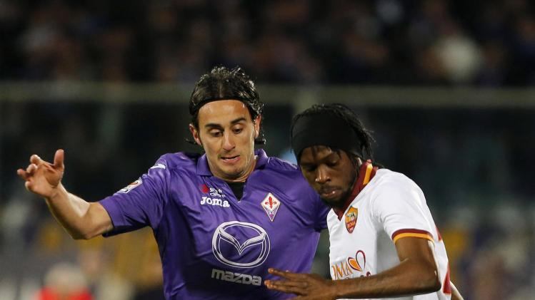 Fiorentina's Aquilani and AS Roma's Gervinho fight for the ball during their Italian Serie A soccer match in Florence