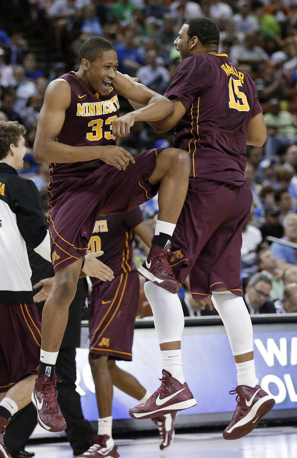 Minnesota's Rodney Williams (33) and Maurice Walker (15) celebrate during a timeout during the first half against UCLA in a second-round game of the NCAA college basketball tournament Friday, March 22, 2013, in Austin, Texas.  (AP Photo/Eric Gay)