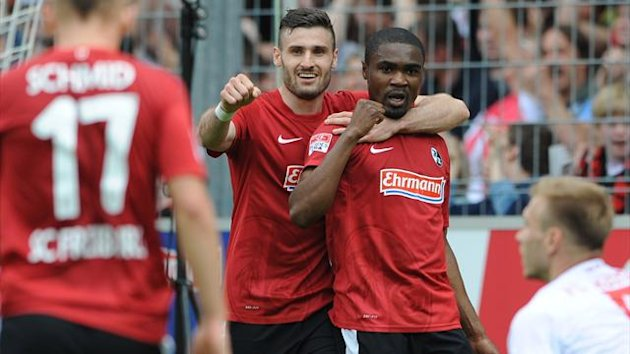Daniel Caliguiri and Cedric Makiaki (SC Freiburg) celebrate a goal against FC Augsburg (AFP)