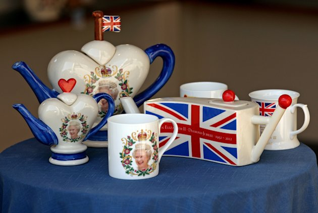 Teapots and Mugs celebrating the Queens Diamond Jubilee, made by Carters Ceramics in Debenham. Image: Chris Radburn/PA