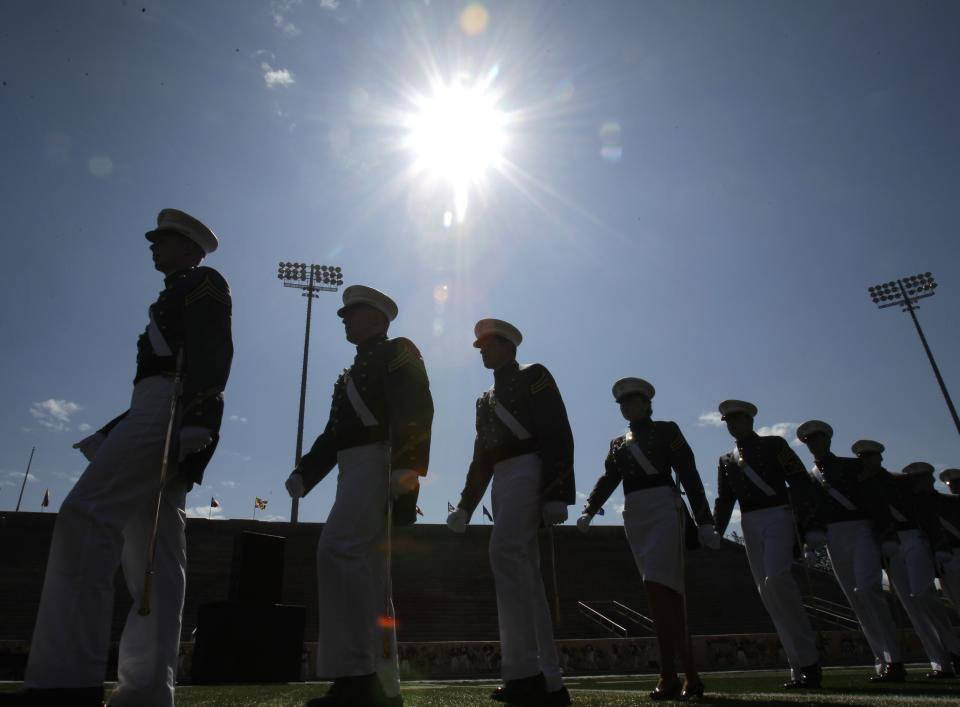 Cadets march into Michie Stadium for a graduation and commissioning ceremony at the U.S. Military Academy in West Point, N.Y., on Saturday, May 21, 2011.   (AP Photo/Mike Groll)