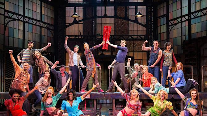 """This theater image released by The O+M Company shows the cast during a performance of the musical """"Kinky Boots."""" The Cyndi Lauper-scored """"Kinky Boots,"""" based on the 2005 British movie about a real-life shoe factory that struggles until it finds new life in fetish footwear, is nominated for 13 Tony Award nominations. The awards will be broadcast on CBS from Radio City Music Hall on June 9. (AP Photo/The O+M Company, Matthew Murphy)"""