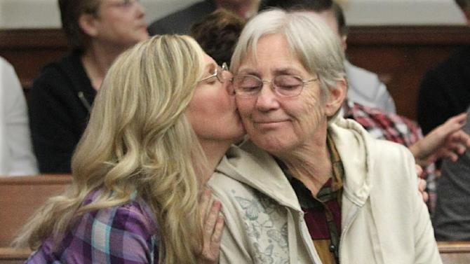 Barb Gray, left, sister of murder victim Timothy Kern, gives a kiss to her mother Ellen Kern, after Brogan Rafferty was sentenced on Friday, Nov. 9, 2012 in Akron, Ohio. Rafferty, 17, was sentenced Friday, Nov. 9, 2012 to life in prison with no chance for parole for his role in a deadly plot to lure men desperate for work with phony Craigslist job offers. (AP Photo/Akron Beacon Journal, Phil Masturzo, Pool)