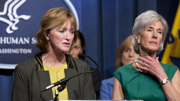 Centers for Medicare and Medicaid Services Acting Administrator Marilyn Tavenner, left, accompanied by Health and Human Services Secretary Kathleen Sebelius,  speaks during a news conference at the Health and Humans Services (HHS) Department in Washington, Wednesday, April 10, 2013, to discuss the Health Department's fiscal 2014 budget.  (AP Photo/Manuel Balce Ceneta)