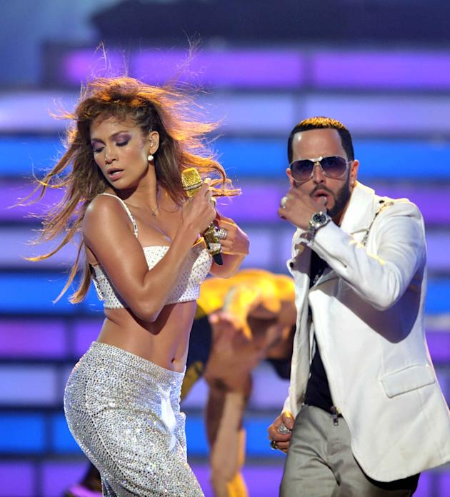 Jennifer Lopez, left, and Yandel, of musical group Wisin Y Yandel, perform onstage at the American Idol Finale on Wednesday, May 23, 2012 in Los Angeles. (Photo by John Shearer/Invision/AP)