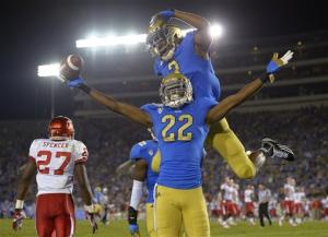 Hundley, defense lead UCLA past Houston 37-6