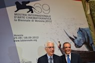 "Venice Film Festival President Paolo Baratta (L) and Director Alberto Barbera pose for photographers in Rome. US cult director Terrence Malick premieres his ""To the Wonder"" starring Ben Affleck at a crisis-themed Venice film festival next month alongside new talent from Guatemala, Nepal and Saudi Arabia"