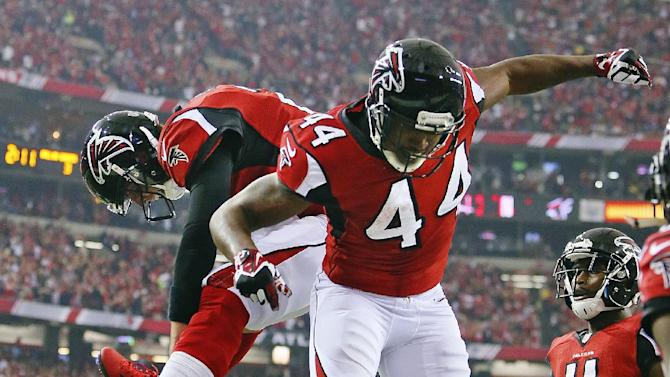 Atlanta Falcons quarterback Matt Ryan, left, celebrates with running back Jason Snelling (44) after Snelling scored a touchdown on a 5-yard pass from Ryan against the Seattle Seahawks during the third quarter of their NFC divisional playoff NFL football game, Sunday, Jan. 13, 2013, in Atlanta. The Falcons won 30-28. (AP Photo/Atlanta Journal-Constitution, Curtis Compton)  MARIETTA DAILY OUT; GWINNETT DAILY POST OUT; LOCAL TV OUT; WXIA-TV OUT; WGCL-TV OUT