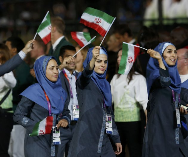 Members of Iran's Olympic team take part in the athletes parade during the opening ceremony of the London 2012 Olympic Games at the Olympic Stadium
