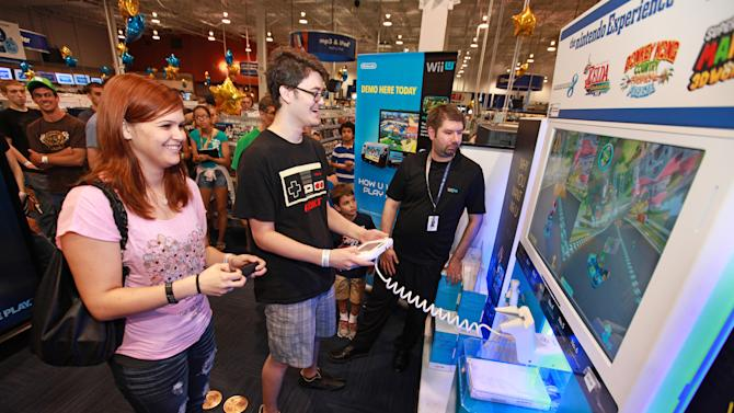 IMAGE DISTRIBUTED FOR NINTENDO OF AMERICA - In this photo released on Wednesday, June 19, 2013, siblings Jocelyn N. and Giovanni N. seen playing Mario Kart 8 at the Nintendo Experience at Best Buy in Schaumburg, Ill. (Photo by Barry Brecheisen/Invision for Nintendo of America/AP Images)