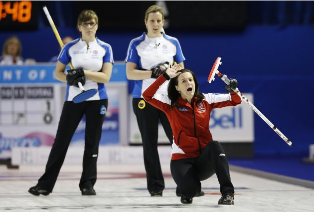 Team Canada skip Nedohin calls a shot in front of British Columbia's Wazney and Carter during their page playoff game at the Scotties Tournament of Hearts curling championship in Kingston