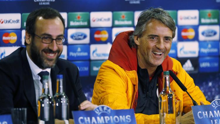 Galatasaray's Manager Mancini reacts during a news conference at Stamford Bridge in London