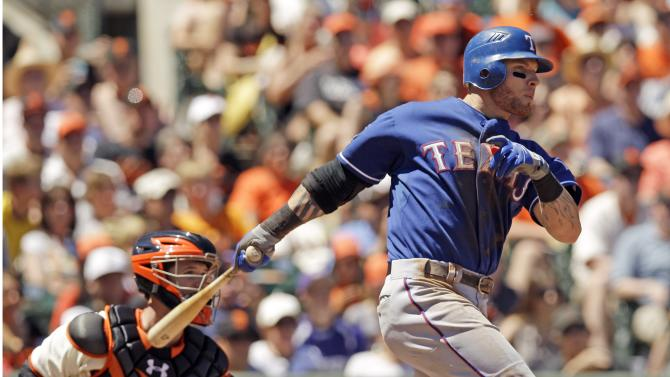 Texas Rangers' Josh Hamilton drives in two runs with a double against the San Francisco Giants during the sixth inning of a baseball game in San Francisco, Sunday, June 10, 2012. (AP Photo/Marcio Jose Sanchez)