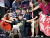China's Zhang reacts among family members after defeating his compatriot Wang in the men's singles final at the World Team Table Tennis Championships in Paris