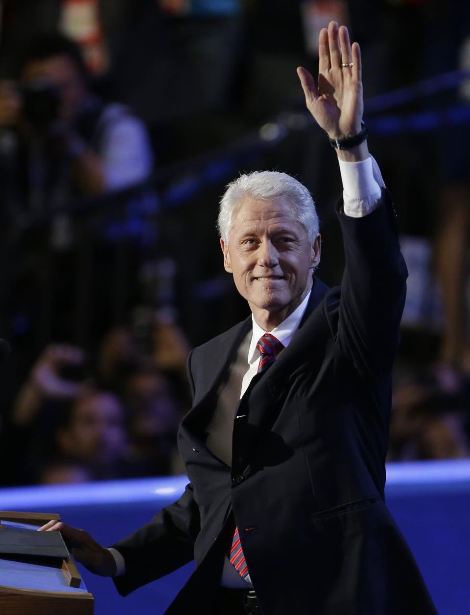 Former President Bill Clinton waves to delegates at the Democratic National Convention in Charlotte, N.C., on Wednesday, Sept. 5, 2012. (AP Photo/Lynne Sladky)