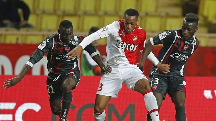 AS Monaco's Anthony Martial challenges Valenciennes's Arthur Masuaku and Saliou Ciss during their French Ligue 1 soccer match at Louis II stadium