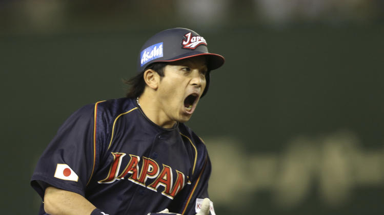 Japan's third baseman Nobuhiro Matsuda shouts while rounding third base after hitting two-run shot off Netherlands' starter Robbie Cordemans in the second inning of their World Baseball Classic second round game at Tokyo Dome in Tokyo, Sunday, March 10, 2013. (AP Photo/Toru Takahashi)