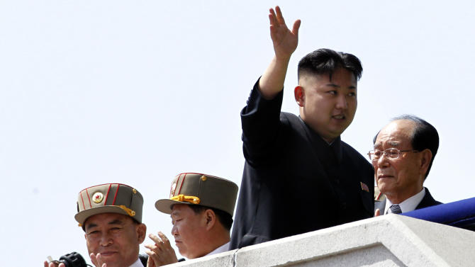 In this photo taken Sunday, April 15, 2012 North Korean leader Kim Jong Un, second from right, waves as he walks past North Korean People's Army senior officers, Vice Marshal and Vice Chairman of the Central Military Commission Choe Ryong Hae, second from left, and Vice Marshal and the military's General Staff Chief Ri Yong Ho, left, and Kim Yong Nam, right, president of the Presidium of the Supreme People's Assembly and the ceremonial head of state during a mass military parade in Kim Il Sung Square to celebrate the centenary of the birth of his grandfather, national founder Kim Il Sung in Pyongyang, North Korea. North Korea said Monday, July 16, 2012 it has relieved Ri Yong Ho from all posts because of illness. (AP Photo/Ng Han Guan)