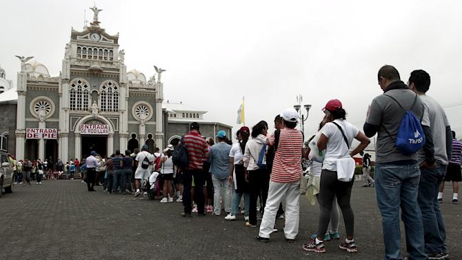 Pilgrims wait in line to enter the Basilica of Los Angeles, during a celebration of the apparition of the Virgin of Los Angeles in Cartago