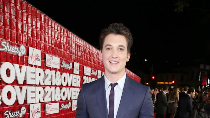 """Miles Teller arrives at the LA premiere of """"21 and Over"""" at the Westwood Village Theatre on Thursday, Feb. 21, 2013 in Los Angeles. (Photo by Eric Charbonneau/Invision/AP)"""