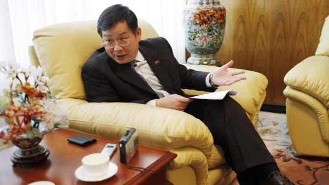In this March 16, 2012 photo, Shen Zhi Liang, China's ambassador to Bolivia, gestures during an interview in La Paz, Bolivia. Shen Zhi Liang said China is exploring ways to cooperate in the industrialization of Bolivia's large lithium reserves and other minerals. (AP Photo/Juan Karita)