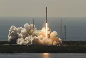 An unmanned SpaceX Falcon 9 rocket launches from Cape…
