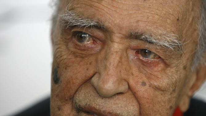 FILE - In this Dec. 12, 2007 file photo, Brazilian star architect Oscar Niemeyer attends his 100th birthday celebration, in Rio de Janeiro, Brazil. According to a hospital spokeswoman on Wednesday, Dec. 5, 2012, famed Brazilian architect Oscar Niemeyer has died at age 104. (AP Photo/ Ricardo Moraes, File)