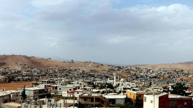 In this Tuesday, Oct. 2, 2012 photo, a general view of Arsal, a Sunni Muslim town eastern Lebanon near the Syrian border. This Lebanese border town has become a safe haven for war-weary Syrian rebels, a way station for wounded fighters and home to hundreds of frightened Syrian refugee families. Residents of Arsal, a Sunni Muslim town of 40,000, have strong motives to help those trying to topple Syria's brutal regime: they themselves were harassed and abused by it during three decades of de facto Syrian control of Lebanon. (AP Photo/Bilal Hussein)