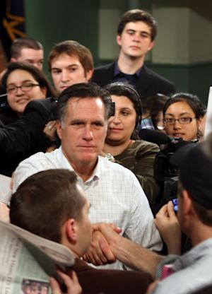 Republican presidential candidate former Massachusetts Gov. Mitt Romney shakes hands after a town hall meeting at the Exeter Town Hall , Thursday, Nov. 3, 2011 in Exeter, N.H. (AP Photo/Jim Cole)