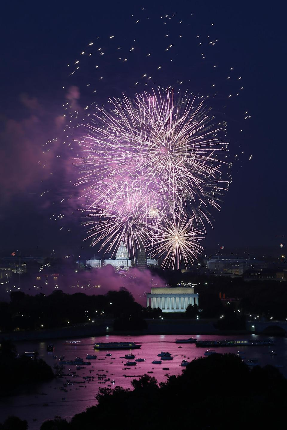Fireworks light the sky over the U.S. Capitol, left, the Washington Monument and the Lincoln Memorial during Fourth of July celebrations, Thursday, July 4, 2013 in Washington. Surrounded by scaffolding, the Washington Monument is closed for repairs after an earthquake in 2011. (AP Photo/Alex Brandon)