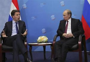 Russia's President Putin speaks with Netherlands' Prime Minister Rutte during their meeting at the International Economic Forum in St. Petersburg