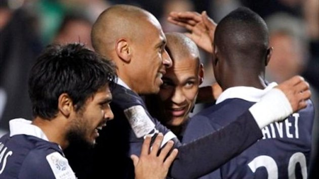 Yoan Gouffran celebrates with Bordeaux team-mates after he scored the winning goal against Marseille (Reuters)