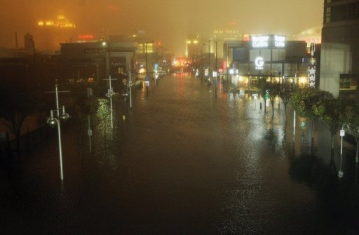 A flooded street is seen at nightfall during rains from Hurricane Sandy in Atlantic City