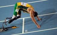 Double amputee Oscar Pistorius, pictured here in 2011, reached the South African national championships 400m final at wind-swept Nelson Mandela University Friday