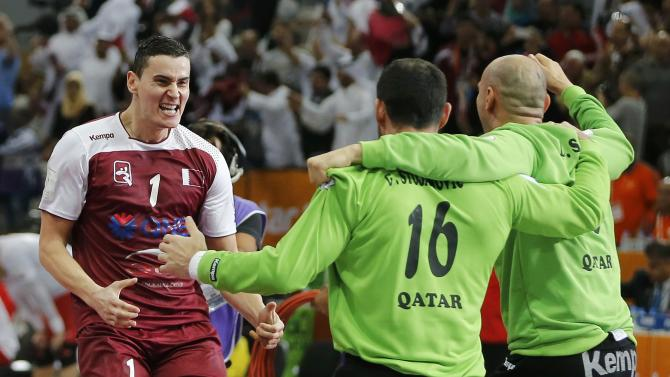 Qatar's Markovic, goalkeepers Stojanovic and Saric celebrate defeating Poland in their semi-final match of the 24th Men's Handball World Championship in Doha