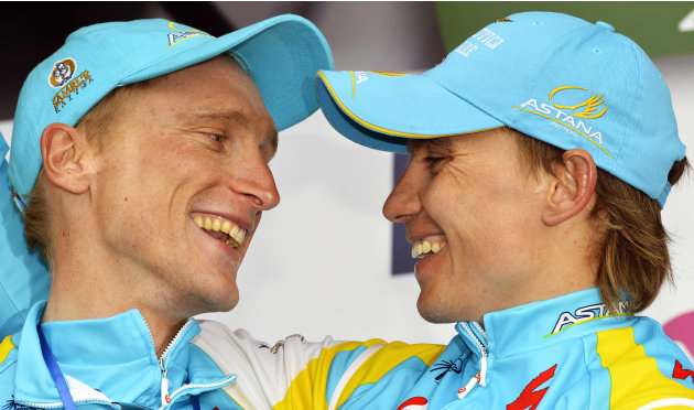 Kazakh Maxim Iglinskiy of Pro Team Astana (1st place) and Italian Enrico Gasparotto of Pro Team Astana (3rd place) celebrate on the podium after the Liege-Bastogne-Liege, one day cycling race, on Apri
