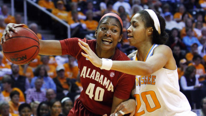 Alabama's Kaneisha Horn (40) drives against Tennessee's Isabelle Harrison (20) in the first half of an NCAA college basketball game on Sunday, Jan. 20, 2013, in Knoxville, Tenn. Tennessee won 96-69. (AP Photo/Wade Payne)