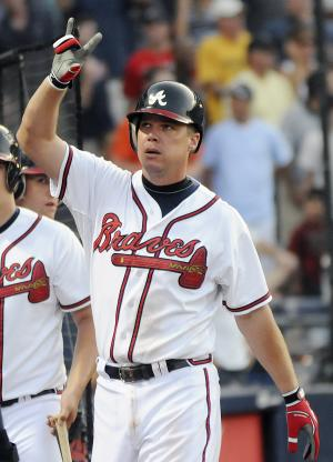 Atlanta Braves batter Chipper Jones reacts to the crowd after he hit a three-run home run off of New York Mets starting pitcher R.A. Dickey during the third inning of a baseball game, Thursday, June 16, 2011, in Atlanta. (AP Photo/Tami Chappell)