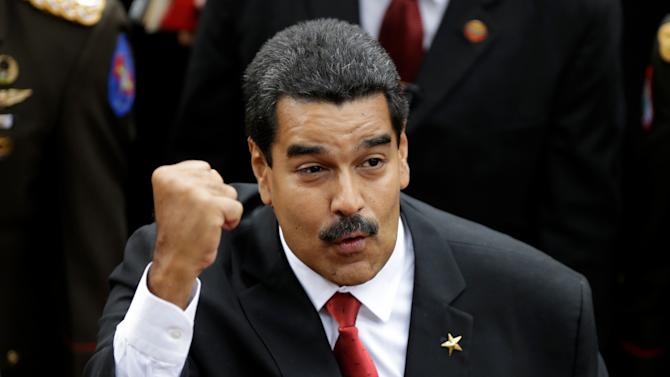 Venezuela's President-elect Nicolas Maduro greets supporters upon his arrival to the Venezuelan Parliament for his swearing-in ceremony in Caracas, Venezuela, Friday, April 19, 2013. The opposition boycotted the swearing-in, hoping that the ruling party's last-minute decision to allow an audit of nearly half the vote could change the result in a the bitterly disputed presidential election. (AP Photo/Fernando Llano)