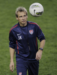 Jurgen Klinsmann, head coach of the U.S. men's soccer team, juggles a soccer ball during a practice in preparation for an international friendly game against Ecuador, Monday, Oct. 10, 2011, in Harrison, N.J. The teams will play at Red Bull Arena on Oct. 11. (AP Photo/Julio Cortez)